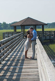 bride and groom kiss n the boardwalk at Mitchelville Freedom Park on HHI