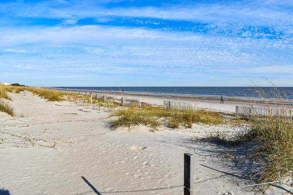 sand dunes offer privacy for a south carolina beach elopement