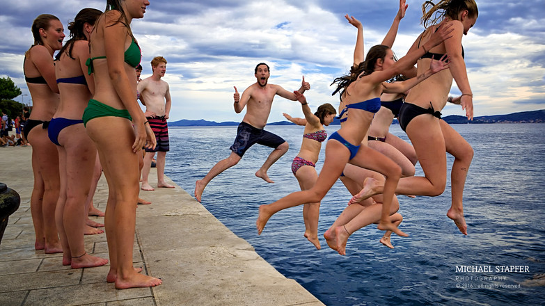 Swimmers at the quay of Zadar.