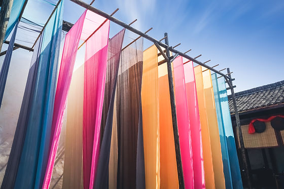 colorful fabric hanging to dry after tra