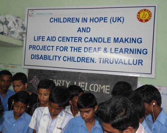 children with banner.JPG