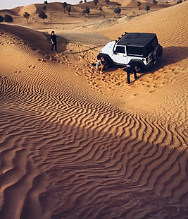 a jeep stuck in a desert off-road in Dubai
