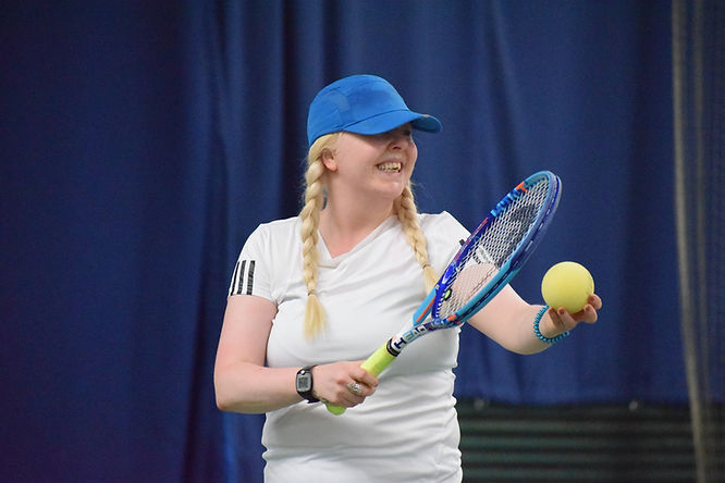 picture shows a visuallly impaired tennis player serving
