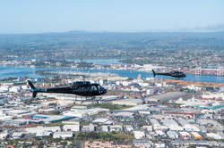 Two Helicopters flying over Tauranga