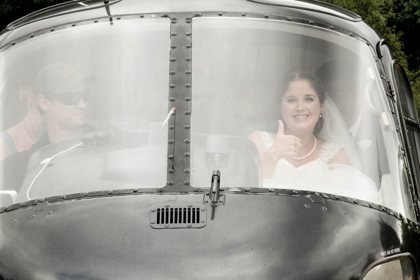 Bride arriving to her wedding in a helicopter