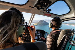 Taking photos of Mount Maunganui from a helicopter