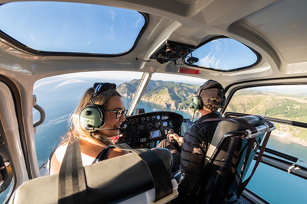 Flying in a helicopter along the coast to Tauranga