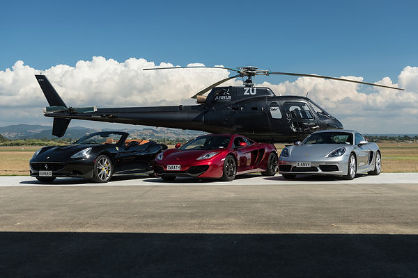Luxury Supercars parked with helicopter