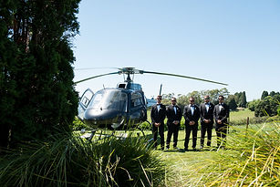 Groom and groomsman arrive to the wedding in a helicopter