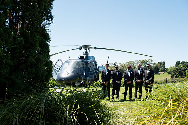 Wedding party arriving by helicopter