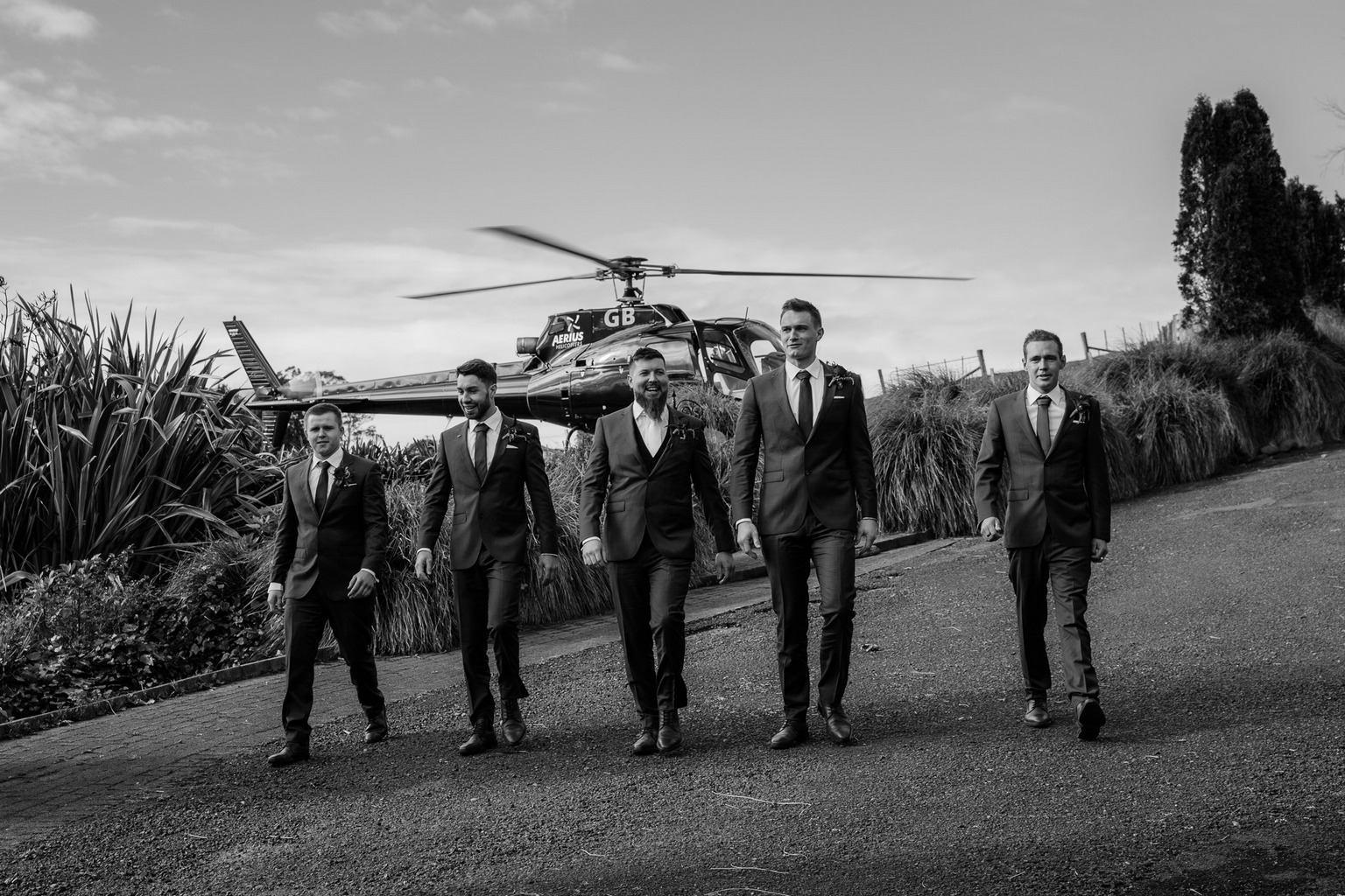 Groomsman arriving to a wedding in a helicopter