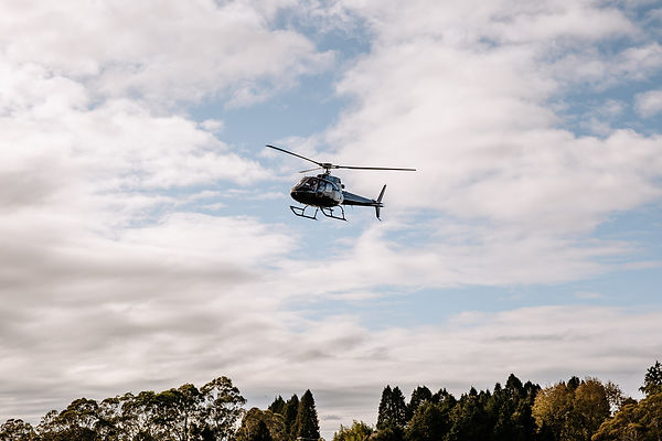 Black helicopter coming into land in Tauranga