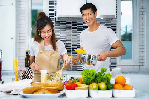 asian-couple-cooking-for-food-and-salad-