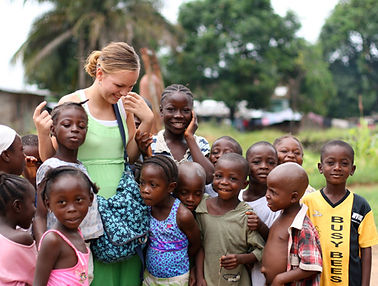 young-woman-on-volunteer-vacation-in-afr