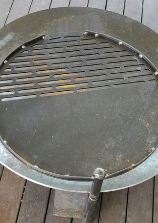 Our brand new fire pits with a BBQ plate for camp fire cooking.