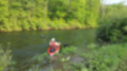 Man Kayaking in a creek at a campground