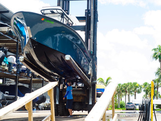 Tired of the boat ramp?  Welcome to hassle free boating.  Inlet Harbor Marina's dry storage facility is your solution to the hassle of trailering and congested public ramps.  Dry storage customers receive the benefits of unlimited in and out service, boat covers removed and replaced, ice and fuel provisioned to the boat prior to your arrival, and discounts on fuel.  Just show up and go enjoy your day on the water!  When you return the friendly staff will take care of rinsing the boat, flushing engines with fresh water and Salt-Away solution, and replacing any covers to protect your investment.  Inlet Harbor Marina operates two Hoist Neptune Marina Forklifts for storing boats up to 25,000 lbs. and 40 ft. length.    Dry storage operations run from 8:00 am - 4:30 pm daily.