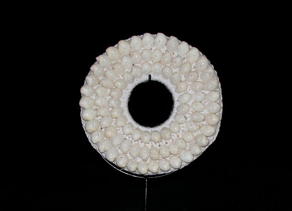 White round shell and macrame decorative piece.