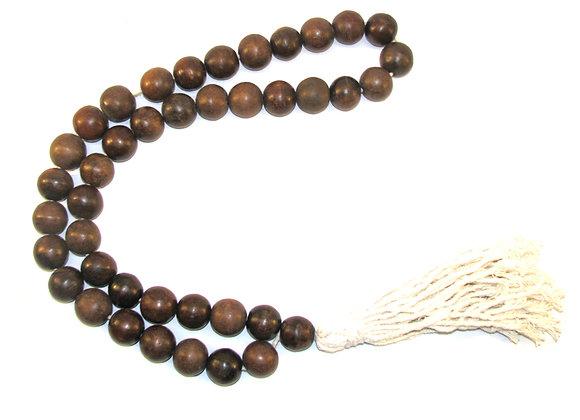 Decorative bead necklace,  large chocolate beads with cream tassel.