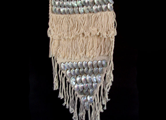 Macrame wall hanging with shell detail.