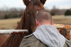 Man standing in front of a horse