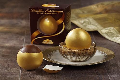 Golden eggs with dark praline in brown gift box