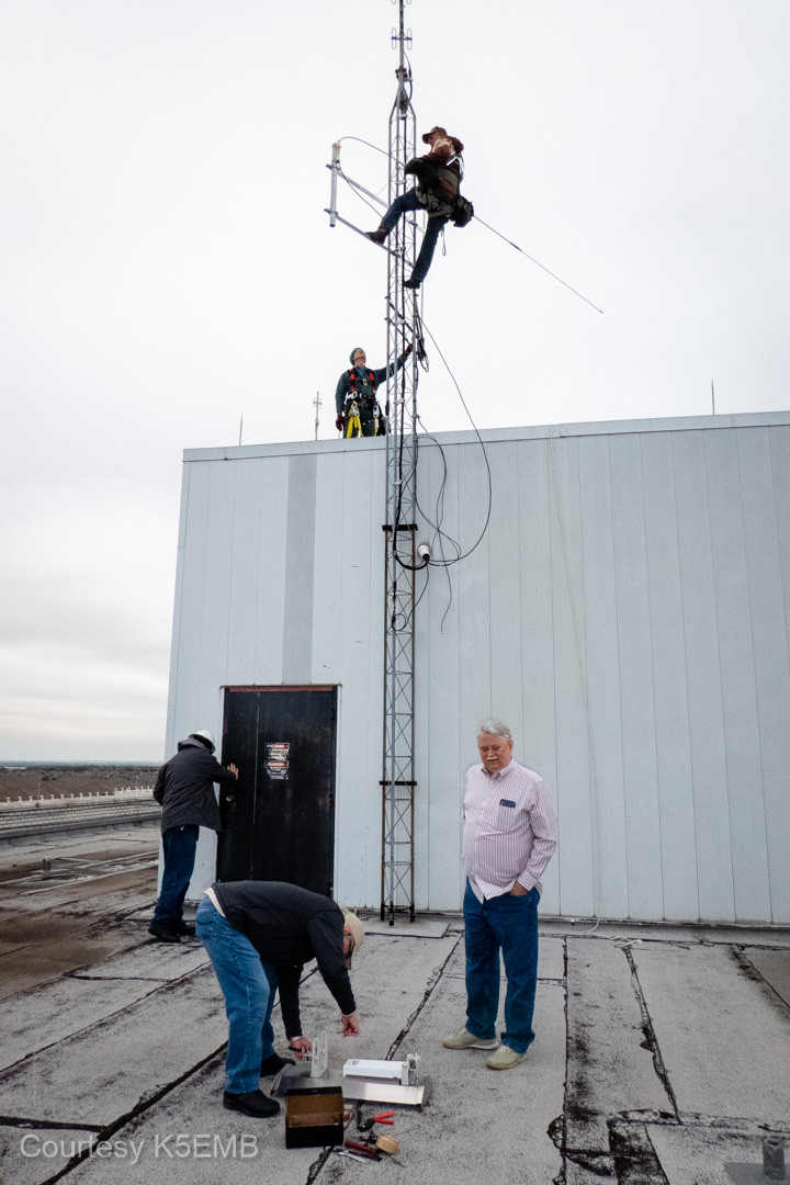 With the Winlink antenna in hand, Jeri Stone begins to mount the antenna