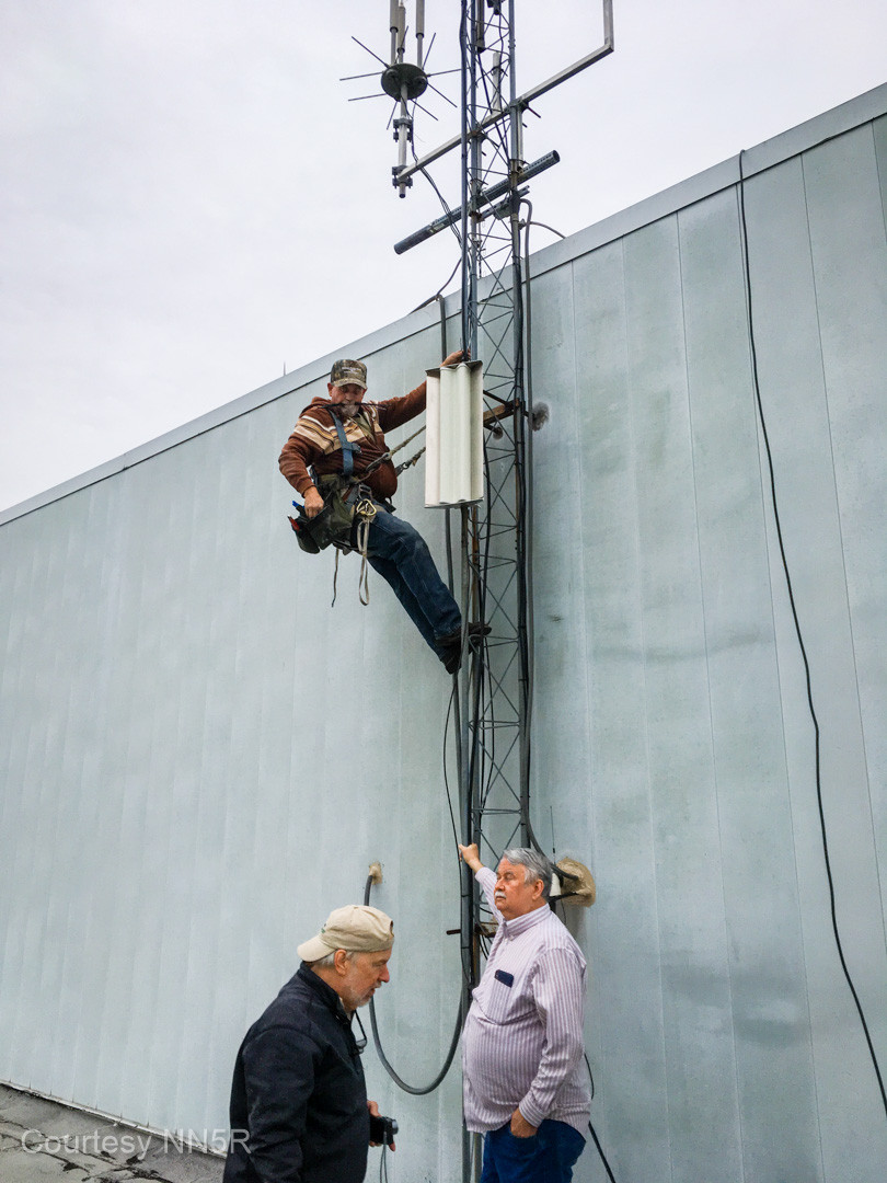 Jeri mounting the north AREDN node while Mike, W5MDB, and Dave, N5GDL, stand by.