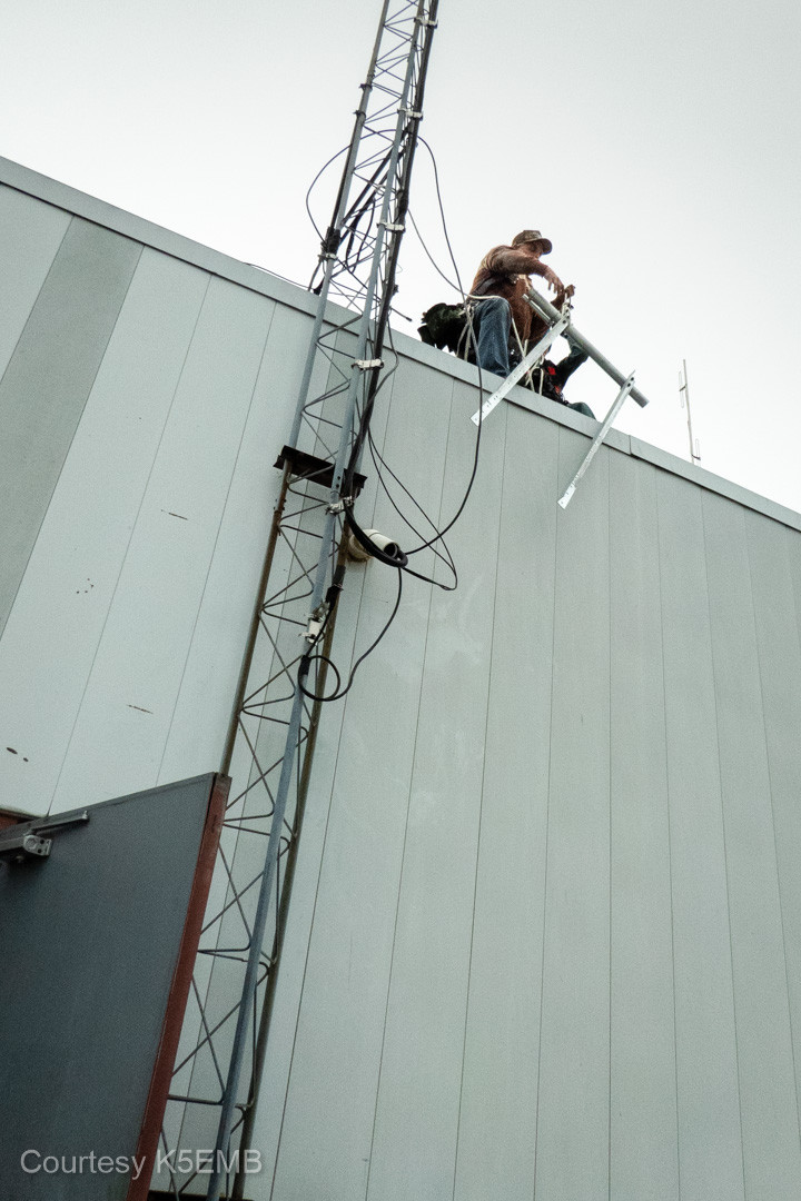 Jeri and Ron, NN5R, hoist the not-so-lightweight extension arm up to the tower.