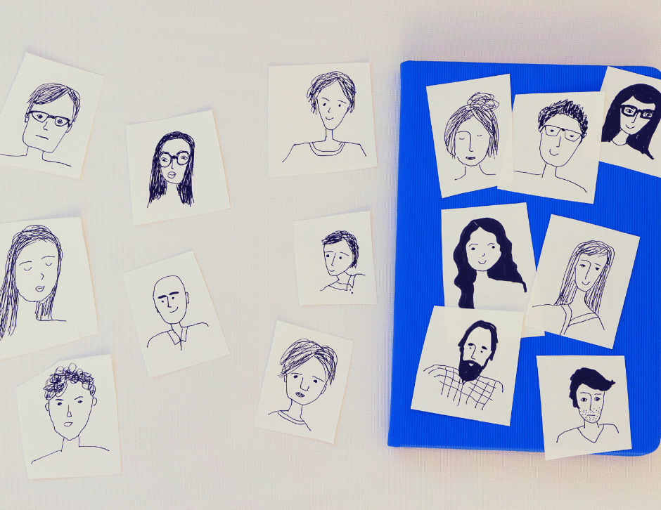 white background with papers with face drawings
