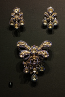Topaz and sapphire bodice ornament and pair of earrings, about 1760.