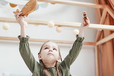 Canva - Girl Holding Wooden Toys.jpg