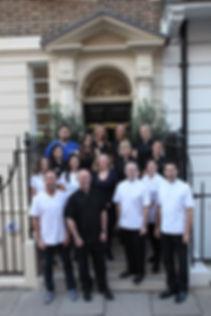 Plowman & Partners team outside 52