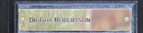 Guy's nameplate on the door of 52