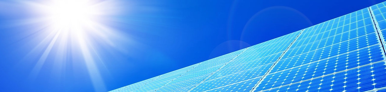 Solar panels against blue sky: on the About Us page