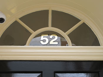 Number 52 above door at Top Private Dentist London