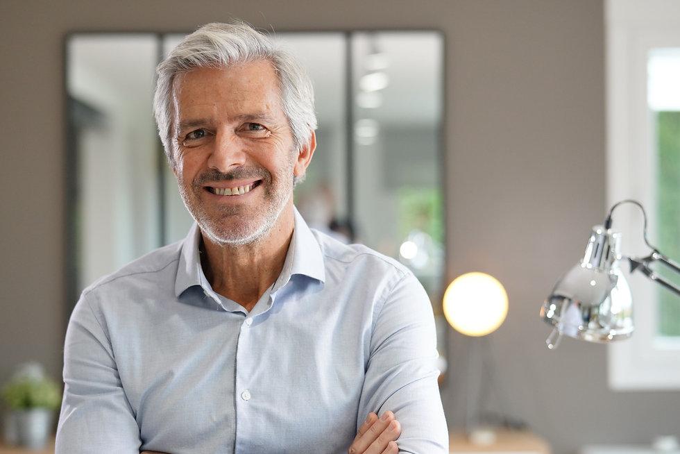 Portrait of senior businessman with arms