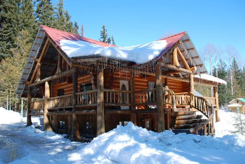 Family Log Home in Winter