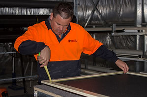Shaun Pink from SP Window Solutions building a security door at his workshop in Adelaide