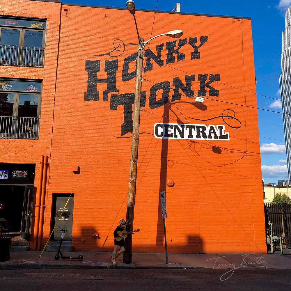 woman playing guitar at Honky Tonk Central