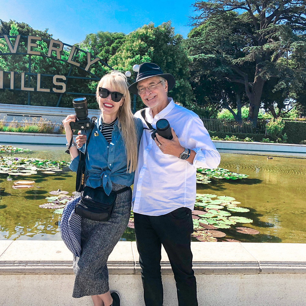 couple in front of Beverly Hills sign