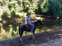 horseback in the river