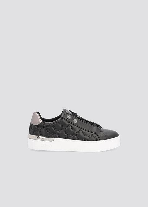 Sneakers noires avec logo effet matelassé