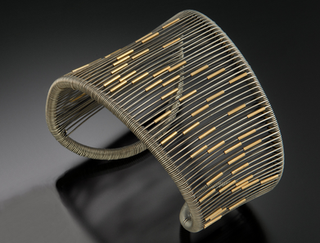 Asymmetrical Cuff with Tubes