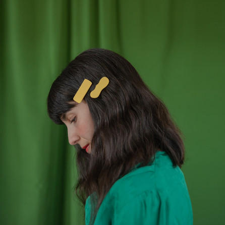 Woman wearing yellow hair clips.jpg