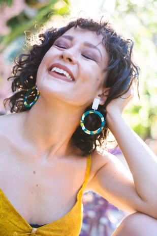 Model wearing green statement earrings l