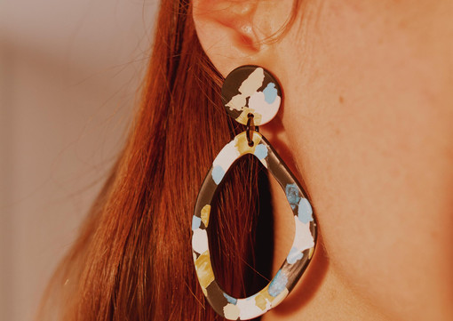 Geometric hoop earrings on a model.jpg