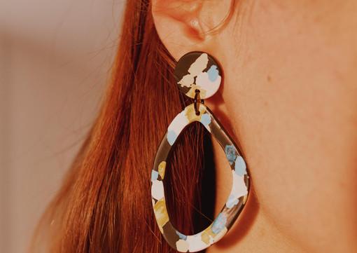 Geometric hoop earrings on a model.jpg