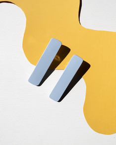 Light blue hair clips on yellow backgrou