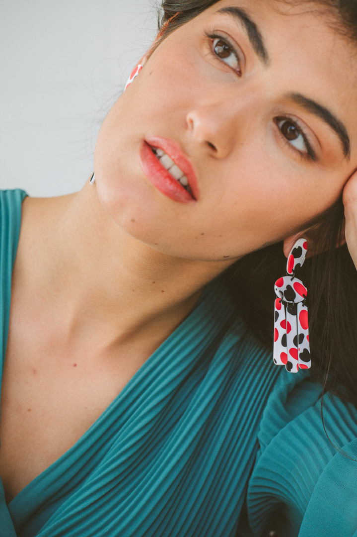Model on colorful statement drops.jpg